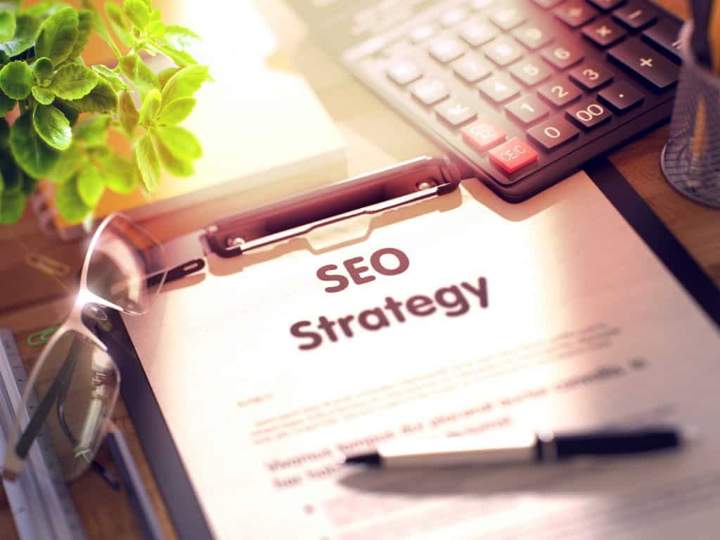 Business Concept - SEO Strategy on Clipboard